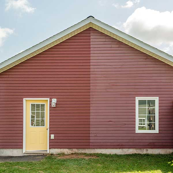 How to restore faded vinyl siding. From looking dull and old, to looking new again. VinylBoost restored the vinyl siding on this house back to its original look.