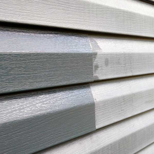 Picture of side of house with partially resorted faded vinyl siding